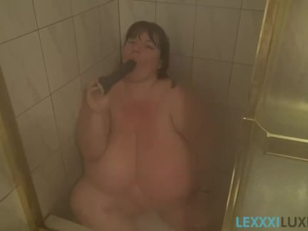Busty BBW Lexxxi Sucks Big Black Dildo in Shower
